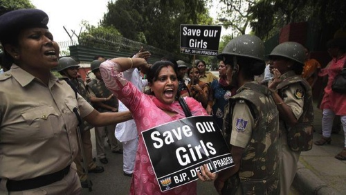 An Indian women activist shouts during a protest against the rape of a 5-year-old girl in New Delhi