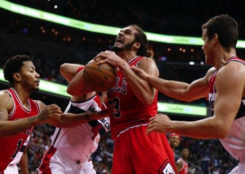 Chicago Bulls center Joakim Noah (13) tries to shoot
