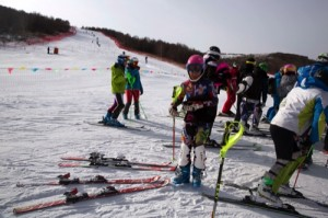Competitors in the FIS Alpine Ski racing gather near a score board after completing their run at a ski resort in Chongli county near Zhangjiakou in northern China's Hebei province