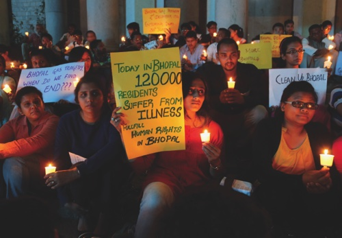 Members of student groups and activists of social organizations participate in a candle light vigil to express solidarity with the Bhopal gas tragedy survivors on the eve of its 30th anniversary in Bangalore