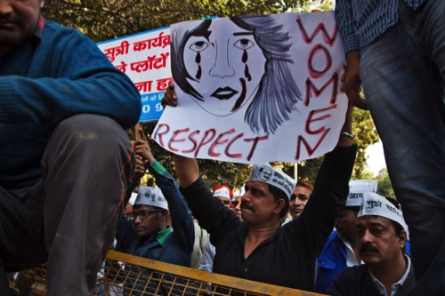Supporters of Aam Aadmi (Common Man) Party (AAP) hold placards during a protest after a woman was allegedly raped by a taxi driver in New Delhi