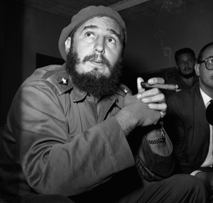 Prime Minister Fidel Castro holds a cigar during a news conference in Havana
