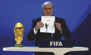 A Thursday, Dec. 2, 2010 photo from files showing FIFA President Joseph S. Blatter announcing that Qatar will be hosting the 2022 Soccer World Cup