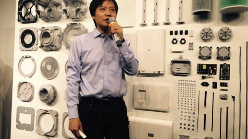 Lei Jun, chief executive officer of Xiaomi Corp., unveils the company's new Mi Air Purifier at a news conference in Beijing, on Tuesday, Dec. 9