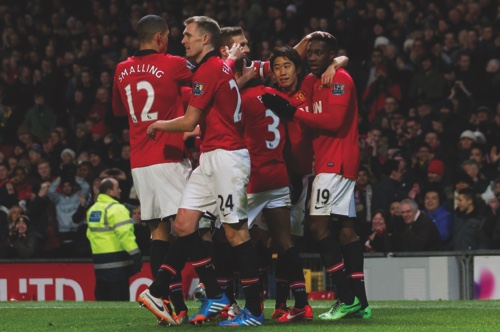 Manchester United's Danny Welbeck, right, celebrates with teammates after scoring against Swansea City during their English Premier League soccer match at Old Trafford Stadium, Manchester