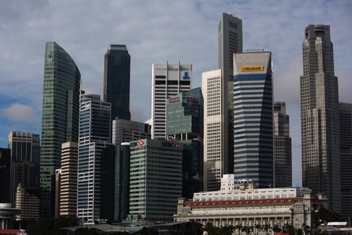 Commercial buildings stand in the central business district of Singapore