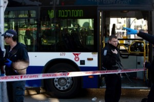 Israeli police officers secure the scene of a stabbing attack in Tel Aviv