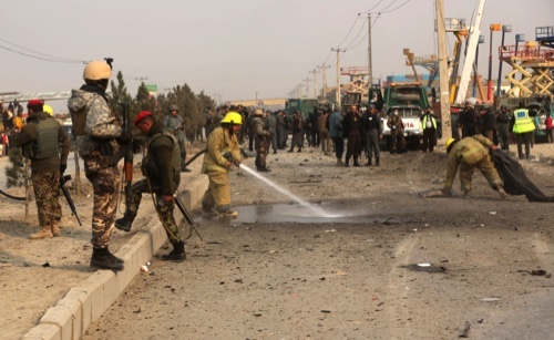 Afghanistan security forces inspect the site of a suicide car bomb attack in Kabul