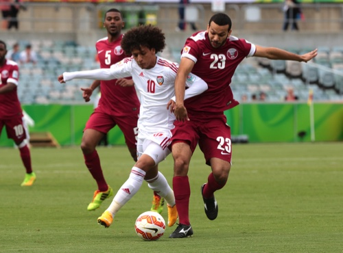 UAE's Omar Abdulrahman, left, and Qatar's Ahmed Mohamed Elsayed battle for the ball during the first round soccer match of the AFC Asia Cup between the United Arab Emirates and Qatar in Canberra, Australia