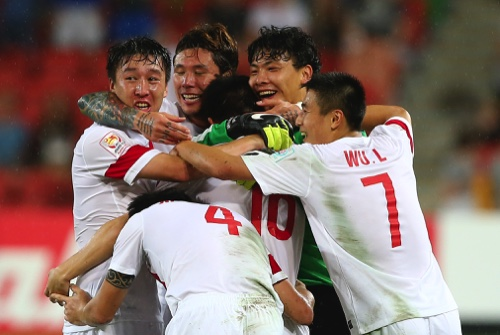The China team celebrate with China's Sun Ke center, after scoring a goal during the AFC Asia Cup soccer match between China and Uzbekistan in Brisbane, Australia