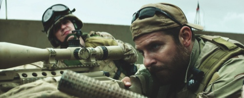 "Kyle Gallner, left, and Bradley Cooper appear in a scene from ""American Sniper"""
