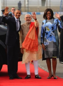 Indian Prime Minister Narendra Modi, center, U.S. President Barack Obama and first lady Michelle Obama wave to the gathering at the Palam Air Force Station in New Delhi