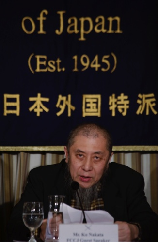 Ko Nakata, an expert on Islamic law, reads a message to hostage takers during a press conference on two hostages held by the Islamic State group, at the Foreign Correspondents' Club of Japan in Tokyo