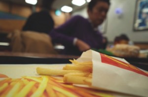 People eat at a McDonald's restaurant in Tokyo