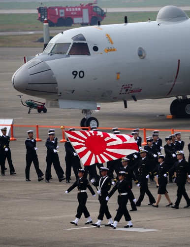 In this Oct. 26, 2014 photo, members of the Japan Self-Defense Forces march during the annual Self-Defense Forces Commencement of Air Review at Hyakuri Air Base, north of Tokyo