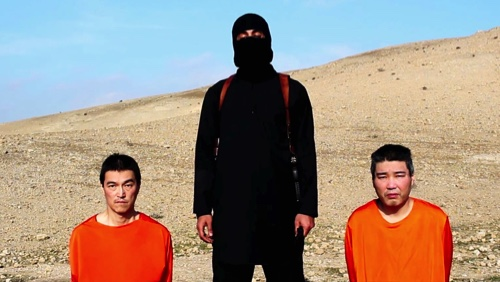 This file image taken from an online video released by the Islamic State on Tuesday shows KenjiGoto Jogo, left, and Haruna Yukawa, right