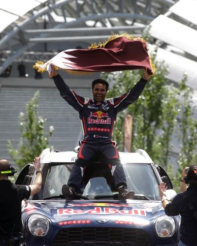 Nasser Al-Attiyah celebrates his victory