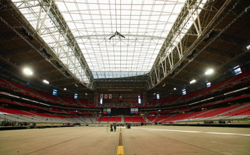 The roof remained closed at University of Phoenix Stadium, where the NFL football's Super Bowl XLIX will be played, while the grass field remained outside in the sun