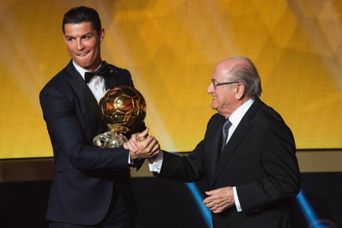 Cristiano Ronaldo, left, of Portugal is being congratulated by FIFA President Joseph Blatter