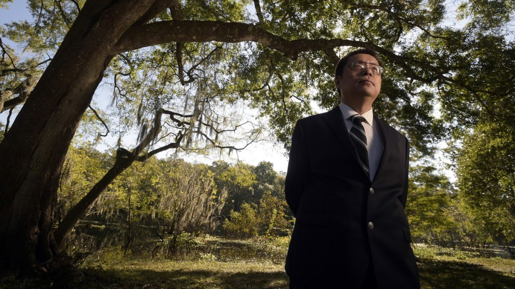 Suspended University of South Florida Professor Dajin Peng stands at a park near the campus in Tampa, Florida, on Oct. 10, 2014.