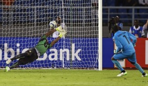 Ghana's goalkeeper Razak Braimah dives as he fails to save the winning penalty from Ivory Coast's goalkeeper Boubacar Barry, during their African Cup of Nations final soccer match in Bata, Equatorial Guinea