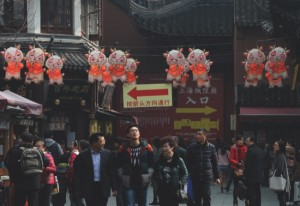 Visitors walk under Lunar New Year decorations on display at Yu Garden in Shanghai
