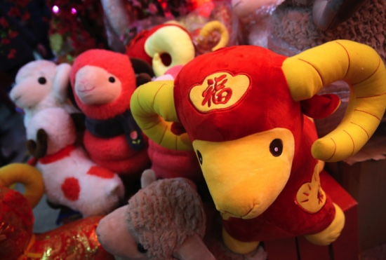 Toy sheep are displayed for sale for Lunar New Year decorations in Beijing