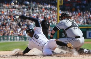 Chicago White Sox catcher Tyler Flowers misplays the throw from center fielder Adam Eaton to allow Detroit Tigers' Rajai Davis to score from third on a single by Miguel Cabrera during the first inning of a baseball game, in Detroit