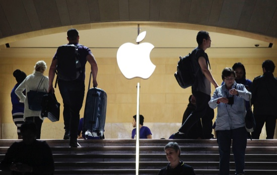 Travelers pass the Apple store at New York's Grand Central Terminal