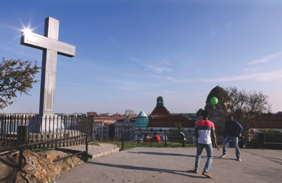 Hamed Kouyate, right, and Jean Paul Apetey, play with a football atop Budapest's Gellert Hill two days after arriving to Hungary after a grueling month long journey across the Balkans