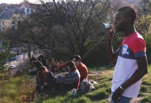 Ivorian Jean Paul Apetey, 34, smokes a cigarette on top of Budapest's Gellert Hill two days after arriving to Hungary