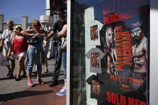 Lots of businesses are predicting record hauls, including secondary ticket sellers, hotel companies, casinos, restaurants, bars, and the state's legal brothels. (AP Photo/John Locher)
