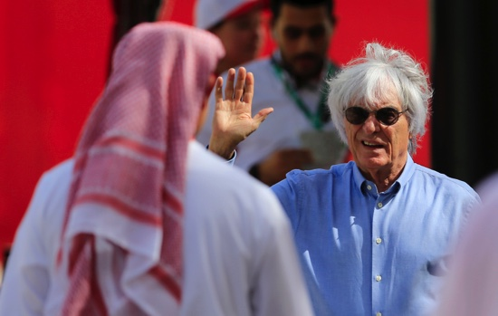 Ecclestone, right, president and CEO of Formula One Management, gestures in the paddock ahead the Bahrain Formula One Grand Prix