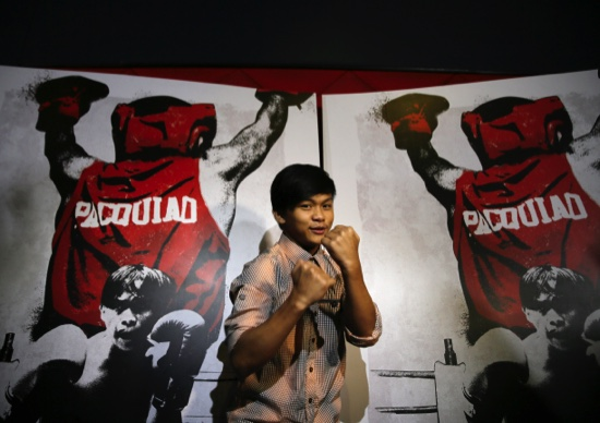 """Filipino actor Buboy Villar, who plays the role of the young Manny Pacquiao, poses before the premiere showing of """"Kid Kulafu"""""""