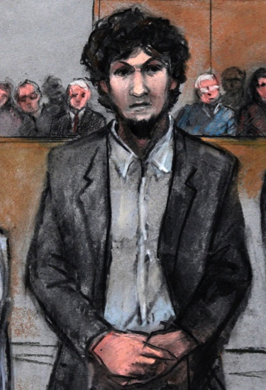 In this courtroom sketch, Boston Marathon bomber Dzhokhar Tsarnaev stands as a death by lethal injection sentence is read at the Moakley Federal courthouse in the penalty phase of his trial in Boston