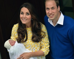 Britain's Prince William stands close to Kate, Duchess of Cambridge as she carries their newborn baby princess as they leave St. Mary's Hospital's exclusive Lindo Wing, London