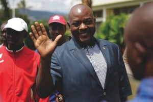 President Pierre Nkurunziza waves as he walks to his car after making a brief statement to the media at the presidential palace in Bujumbura