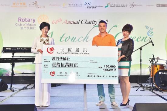 Donation check presentation from Major Sponsor, Sai Hang Telecom's Mr Chong