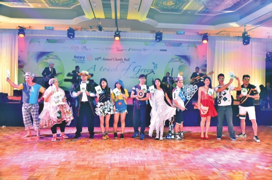 """"""" Eco-friendly ' Fashionista with Rotarians and Rotaractors modeling their creative designs  made from recycled materials"""