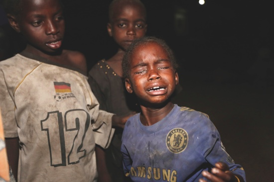 A child rescued by Nigerian soldiers from Boko Haram extremists at Sambisa Forest cries after arriving with others at a refugee camp in Yola, Nigeria