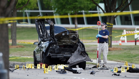 FBI crime scene investigators document evidence outside the Curtis Culwell Center