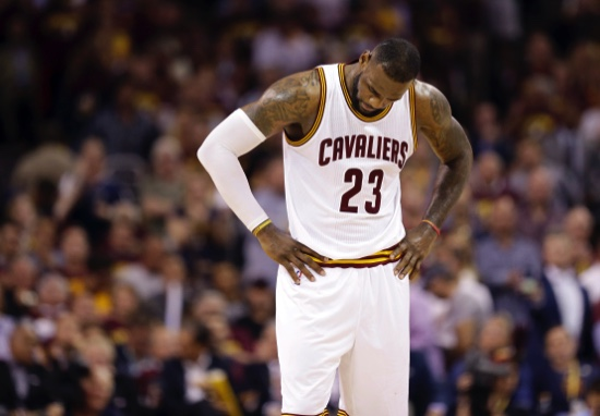Cleveland Cavaliers forward LeBron James (23) hangs his head during the second half of Game 6 of basketball's NBA Finals against the Golden State Warriors