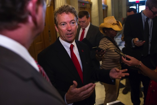 Sen. Rand Paul, R-Ky., talks with reporters outside of the Senate Chamber following his address to the Senate in Washington