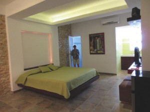 Majel Reyes in the apartment she renovated to rent to visitors via Airbnb and other sites, in Havana