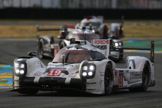 The Porsche 919 Hybrid No19 of the Porsche Team, with drivers Nico Hulkenberg of Germany, Earl Bamber of New Zealand and Nick Tandy of Great Britain, leads the race
