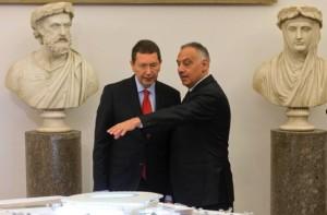 Roma President James Pallotta, right, shows Rome's Mayor Ignazio Marino the project for the new Roma football stadium, at Rome's Capitol Hill