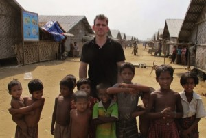 American actor Matt Dillon poses with Rohingiya children at a camp for refugees, north of Sittwe in the western state of Rakhine