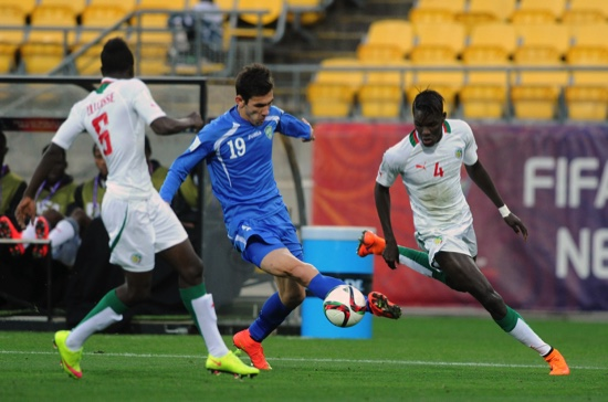 Zabikhillo Urinboev of Uzbekistan, center, looks to run between Senegal's Papa Diene Faye