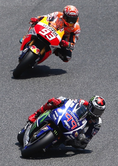 Moto GP rider Jorge Lorenzo steers his motorcycle followed by Marc Marquez during the Catalonia GP