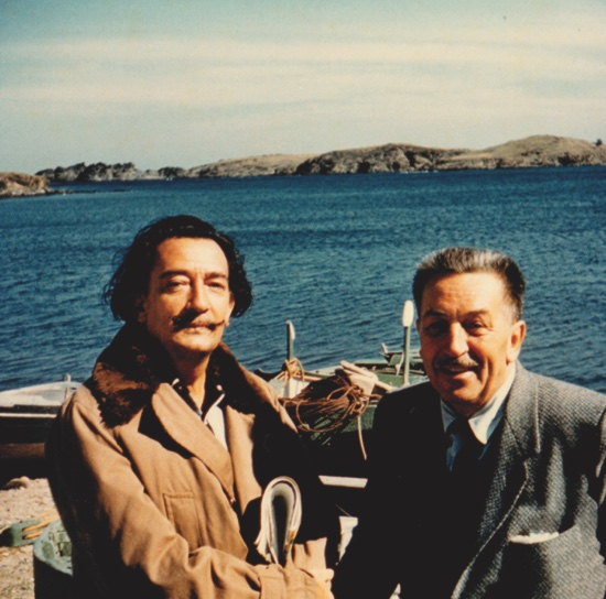 This 1957 photo released by the Walt Disney Family Foundation shows surrealist artist Salvador Dali, left, and Walt Disney at a beach in Spain